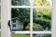 Wendy House in Rock Cottage garden seen through the cottage window.